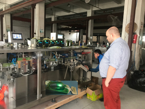 Russia customer visiting and checking plastic bottle filling sealing machine in the factory